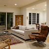 """Nighttime view of the living room from the other end.  Dining room is to the right.  The sliding glass doors at the end of the room open to the so-called """"three season room."""""""