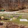 Garden plots of Kendal residents.  The plots are fenced to keep out the deer.  In the foreground, several new plots -- to be fenced later -- are being laid out to accommodate increased demand from the new cottage occupants.  The road up the hill to the rear leads through dense woods to the contiguous Kendall Crosslands community, which was established about four years after Kendal Longwood.