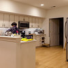 """Kitchen, nighttime.  The door to the rear leads to the """"mudroom,"""" which has the washer and dryer, a second large pantry closet, another large closet and many more cabinets."""