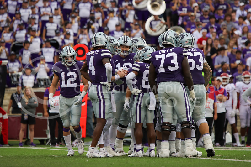 The Wildcat offense huddles up before a play in the game against OU on October 2nd (Kendall Spencer   Collegian Media Group).