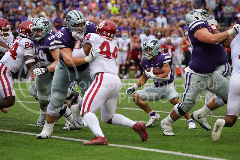 Deuce Vaughn, Sophomore in Business Administration, runs through a gap in the action in the game against OU on October 2nd (Kendall Spencer   Collegian Media Group)
