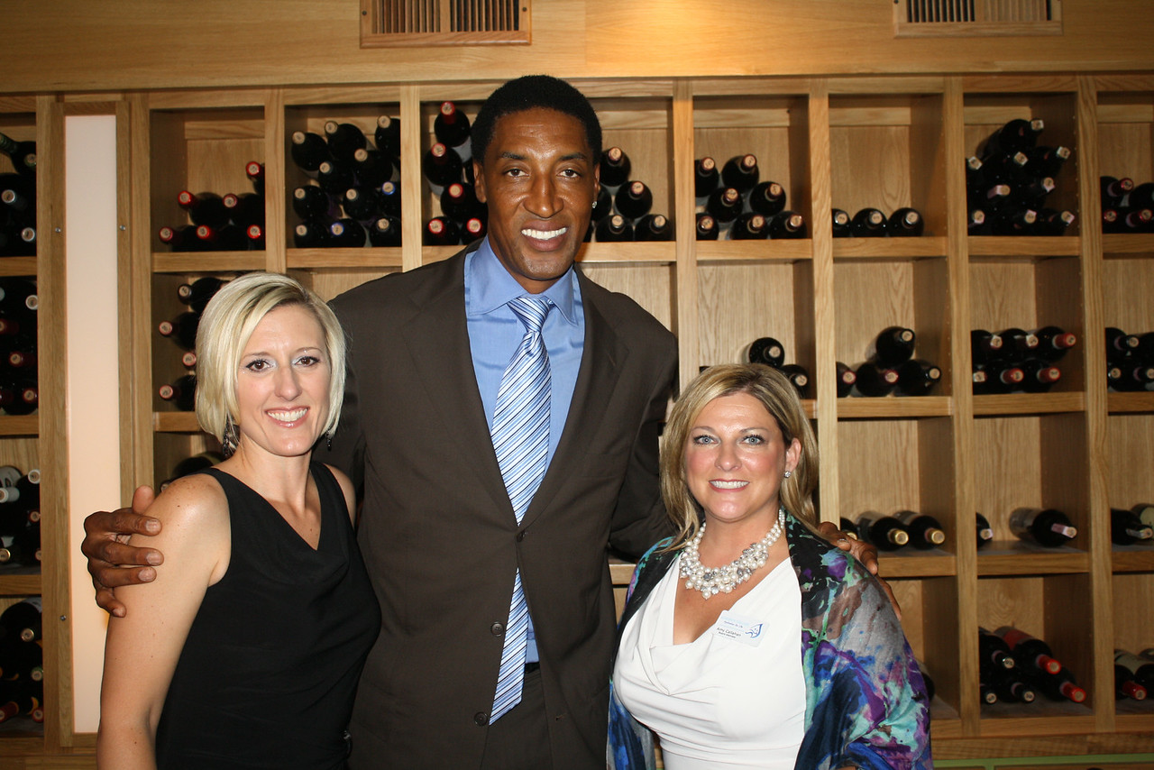 Event co-chairs Meredith Wiktorowski and Amy Callahan with Scottie Pippen