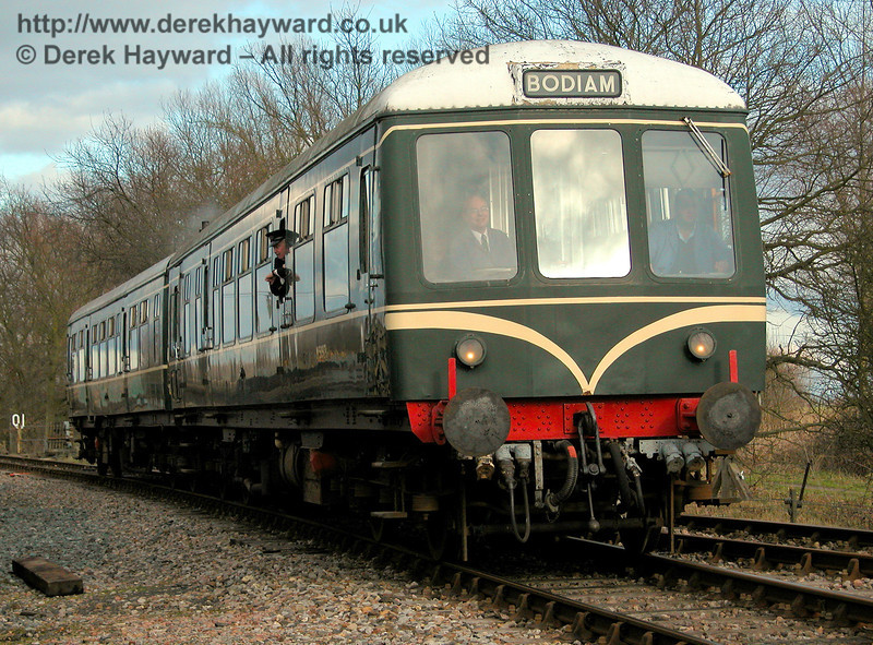 The DMU approaches Wittersham Road with a westbound train. 17.02.2006