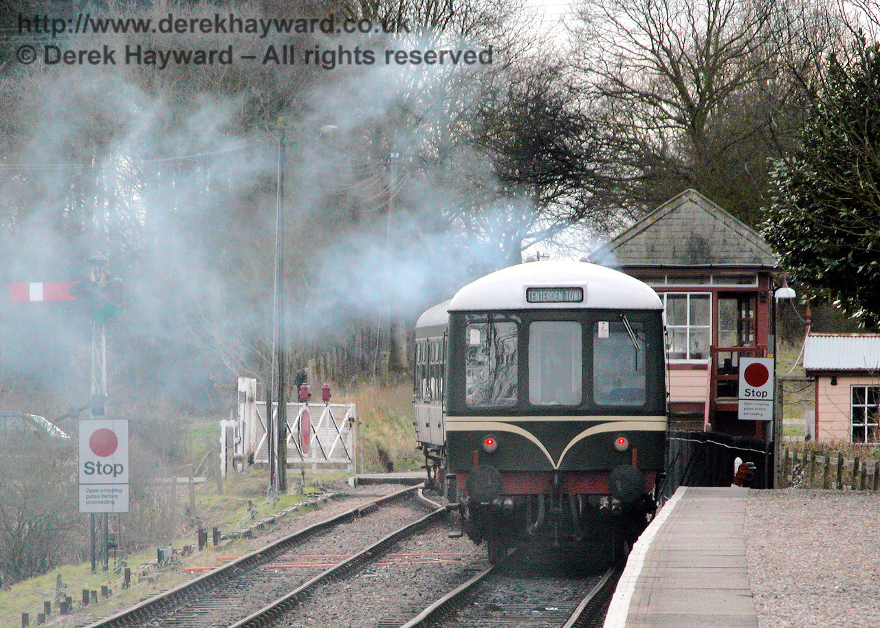 It is not steam hauled - it is just smoke!  The DMU makes an interesting departure from Wittersham Road. 17.02.2006