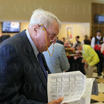 Bob Jones focused on selecting a horse for the next race.
