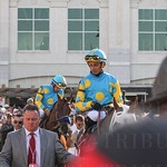 The Zayat jockeys Victor Esponoza and Martin Garcia head towards the track.