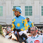 The Zayat jockeys Victor Espinoza and Martin Garcia head towards the track.