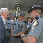 Governor Steve Bashear chats with some state troppers in the paddock..