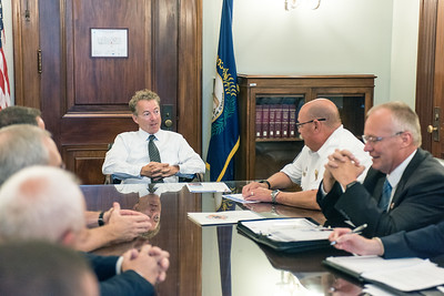 Senator Rand Paul (R-KY) discusses permanent EMS Medicare reimbursement reform with Kentucky Ambulance Providers Association president Thomas Adams and Kentucky Board of Emergency Medical Services executive director Michael Poynter, along with the rest of the ambulance association's Congressional Delegation in the Russell Senate Office Building.