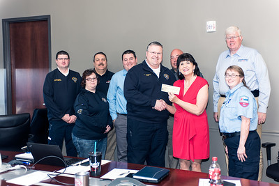Emergency Medical Educators of Kentucky president Mabel Murray presents a donation of $1,200 to Kentucky EMS Memorial Foundation chair Aaron Stamper.