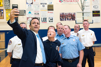 "Kentucky Governor Matt Bevin poses for a ""selfie"" with EMS representatives at the ceremonial signing of Kentucky Senate Bill 33."