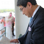 Tsuyoshi ( Terry) Kurihara read the racing program.