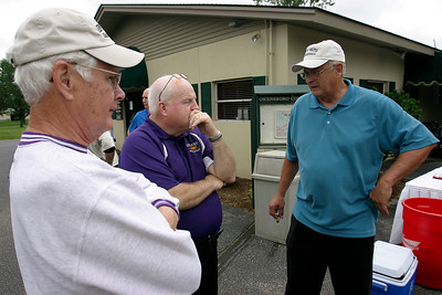 Joel Utley and Roy Pickerill talk with former coach Wayne Chapman Friday afternoon during the Golf Scramble at Owensboro Country Club. The scramble was part of the Kentucky Wesleyan College Basketball 100th Anniversary celebration.