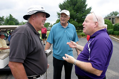 Former coach Wayne Boultinghouse talks with Roy Pickerill as Wayne Chapman looks on Friday afternoon during the Golf Scramble at Owensboro Country Club. The scramble was part of the Kentucky Wesleyan College Basketball 100th Anniversary celebration.