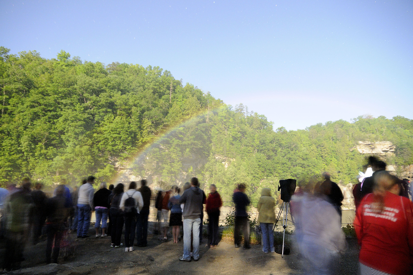 People line up along the viewing area for the Moonbow, a natural occurrence when the light from a full moon causes a rainbow to appear at night in the mist of the waterfall, at Cumberland Falls State Resort Park in Corbin, KY on Friday, May 24, 2013. Copyright 2013 Jason Barnette