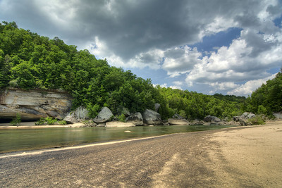 A wide, sandy beach facing a sheer rock cliff across the river at Cumberland Falls State Resort Park in Corbin, KY on Tuesday, May 28, 2013. Copyright 2013 Jason Barnette