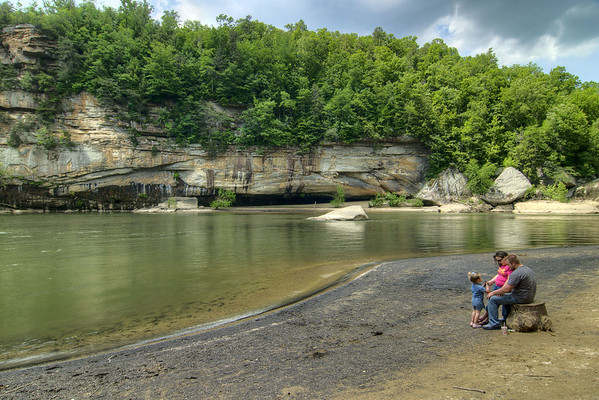 A family enjoys the wide, sandy beach along the river at Cumberland Falls State Resort Park in Corbin, KY on Tuesday, May 28, 2013. Copyright 2013 Jason Barnette