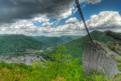 The city of Pineville sits far below Chained Rock, a massive boulder which was chained to the mountainside in 1932, in Pine Mountain State Resort Park in Pineville, KY on Tuesday, April 24, 2012. Copyright 2012 Jason Barnette