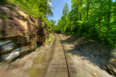 A little bit of motion blur while riding at the back of the passenger car on the Big South Fork Scenic Railway, a 14-mile scenic trip along the old Stearns Coal & Lumber Company railroad tracks to the Blue Heron Mining Camp, in Stearns, KY on Monday, May 27, 2013. Copyright 2013 Jason Barnette