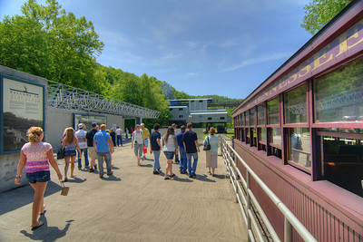 Visitors disembark the train at the train station, entering the Blue Heron Mining Camp in Stearns, KY on Monday, May 27, 2013. Copyright 2013 Jason Barnette  The Blue Heron Mining Camp is located about 10 miles outside Stearns. Also known as Mine 18, it was operated by the Stearns Coal and Lumber Company from 1937 - 1962.  Today the camp is open to the public and managed by the National Park Service as part of the Big South Fork National River and Recreation Area.