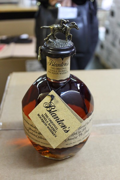 A bottle of bourbon has an iconic horse and jockey cap