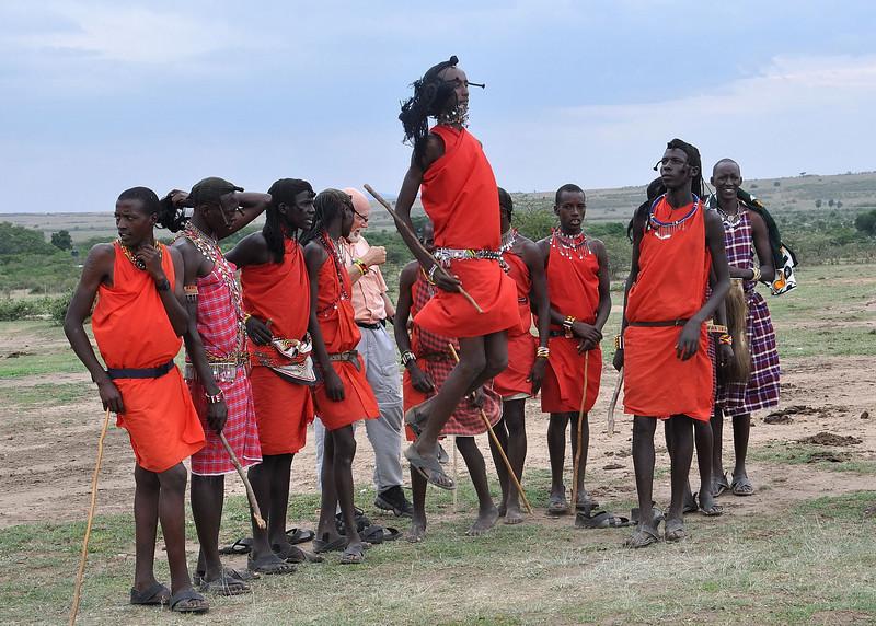 The warriors doing a jump dance.