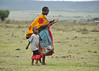 Masai mother beckoning to her child to come to her.  Her child was the little girl in the previous photo.