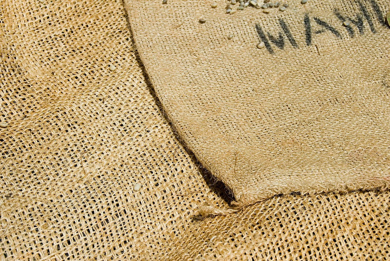 It is the same material used to bag the coffees for transport but of a coarser weave for good bean ventilation while drying.