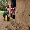 Young Maasai boys and water bucket