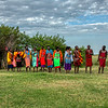 Maasai villagers line up to welcome visitors