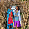 Two Maasai women at the village entrance
