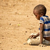 A pensive Maasai boy and his toy