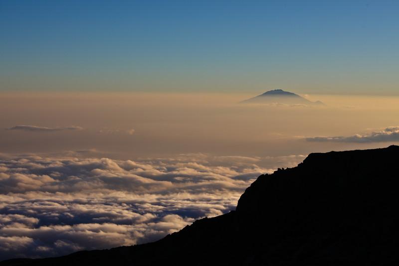 mt meru poking above the clouds