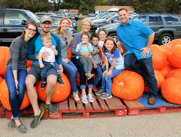 Roger Schneider | The Goshen News The Weddle and Storer families used some large pumpkins at Kercher's Sunrise Orchard and Farm Market as props as they pose for a family photo Saturday. From left are Esther, Jordan and Micah Weddle, Ashley Store, Julie Weddle and Evelyn, Isaac, Madeline, Molly and Adam Storer. The Weddles are from Goshen and the Storers are formerly of Goshen and now live in Washington, D.C.