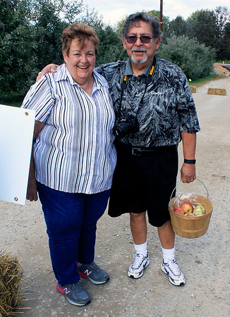 Roger Schneider | The Goshen News<br /> Sue and Joe Menchaca of Warsaw picked some apples Saturday at Kercher's Sunrise Orchard and Farm Market's Fall Harvest Festival.