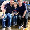 Roger Schneider | The Goshen News<br /> Dave and Elaine Lange of Mishawaka and their grandson Colin Amstutz, 4, Mishawaka sit in the back of a farm truck for a family photo Saturday during Kercher's Sunrise Orchard and Farm Market's Fall Harvest Festival.