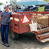 Roger Schneider | The Goshen News<br /> Brian Baer of Bristol waits for a new batch of riders for his hay wagon. Baer was giving rides at Kercher's Orchard and Farm Market Saturday.