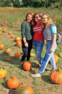 Roger Schneider | The Goshen News Janet Holzman, center, of Chicago, poses for a photo with her daughters, Lindsay, 16, left, and Marley, 20. They were  picking out pumpkins during the fall harvest festival at Kercher's Sunrise Orchard and Farm Market in Goshen.