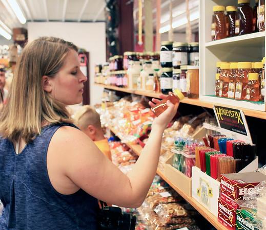 Roger Schneider   The Goshen News<br /> Melissa Fackelman of Bristol looks at the honey for sale at Kercher's Sunrise Orchard and Farm Market.
