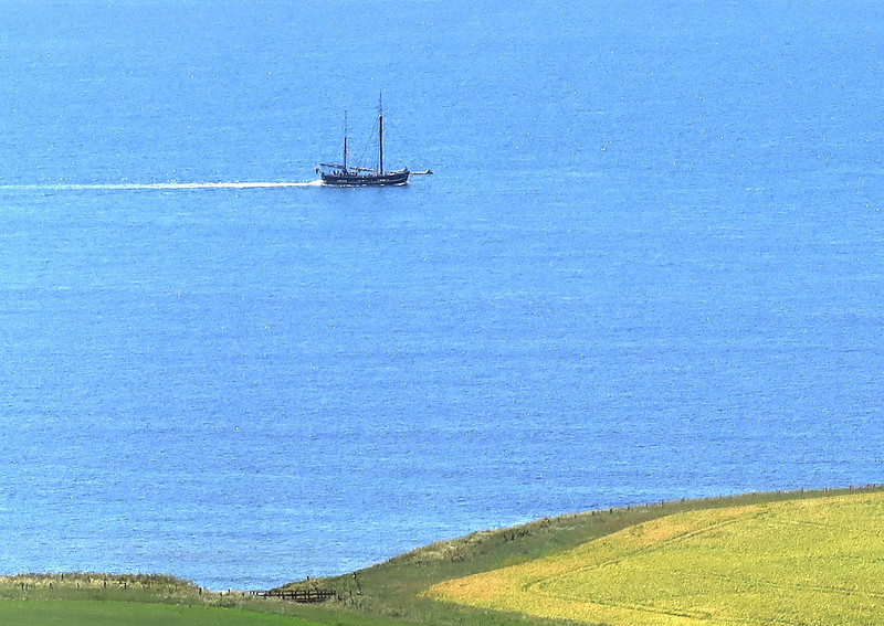 A tourist boat travels westward off Kimmeridge