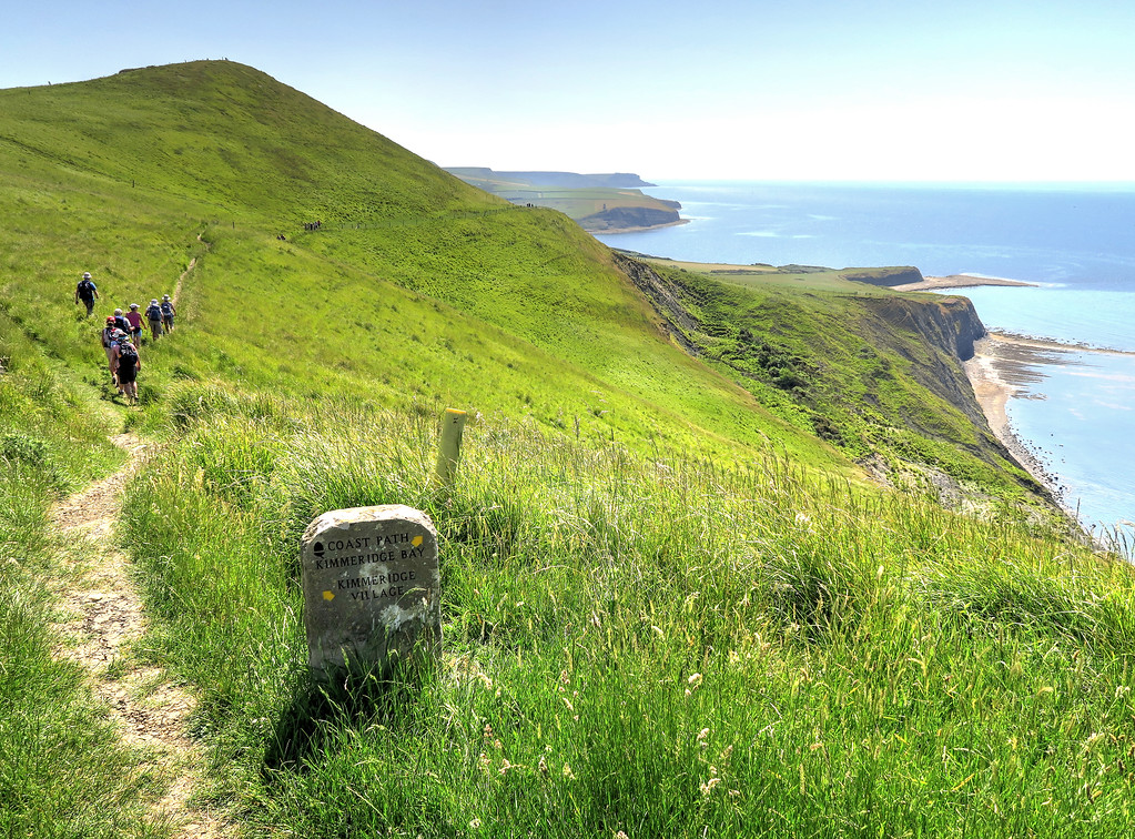 Walking to the East along Gad Cliffs - Clavell Tower is just visible standing on the far side of Kimmeridge Bay