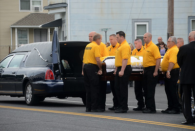 Tania Barricklo-Daily Freeman  Members of the Ulster County dive team served as pall bearers Thursday at the funeral of their fellow diver Kerry Winters.
