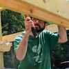 Kevin Lavoie, part of a special needs boyscout troop, has recently become an eagle scout. Pictured behind is a pergola at GAAMHA in Gardner that he built with the help of family and fellow scouts. Courtesy Photo