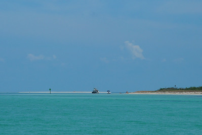 In 2005 when Hurricane Wilma came past the Keys, the extremely high tide deposited a sand island just to the north of the channel next to Boca Grande.  This low lying sandy island was given the name of Bruce Key and is now a bird sanctuary.  This is the island on the left in the picture and 11 miles west of Key West.