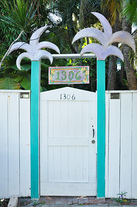 Palm tree posts on your gate.