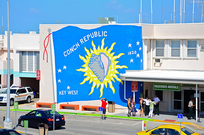Passengers arriving at the Key West International Airport (sorry, but there are no international flights) are greeted by a full-size painting of our Conch Republic flag.