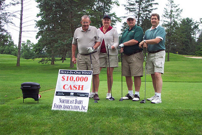 L to R: Earl Fink, Exec. VP of the PA Association of Milk Dealers/Harrisburg PA; Kim Bukowski and Dave LaRoche of Randolph Associates; Bruce Krupke, Exec. VP Northeast Dairy Foods Assoc. Syracuse, NY get ready to hit a hole-in-one for $10,000