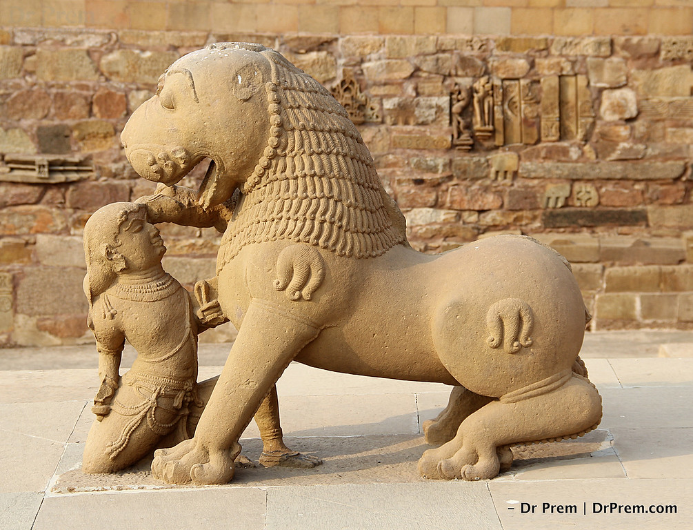 A Warrier fighting with a lion bare handed  at the entrance of the temple.
