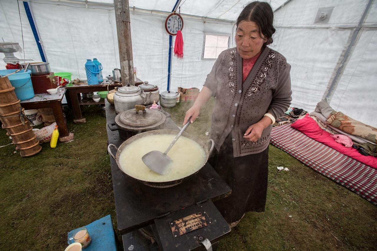 Making yak cheese. Nomad family. Namsai.