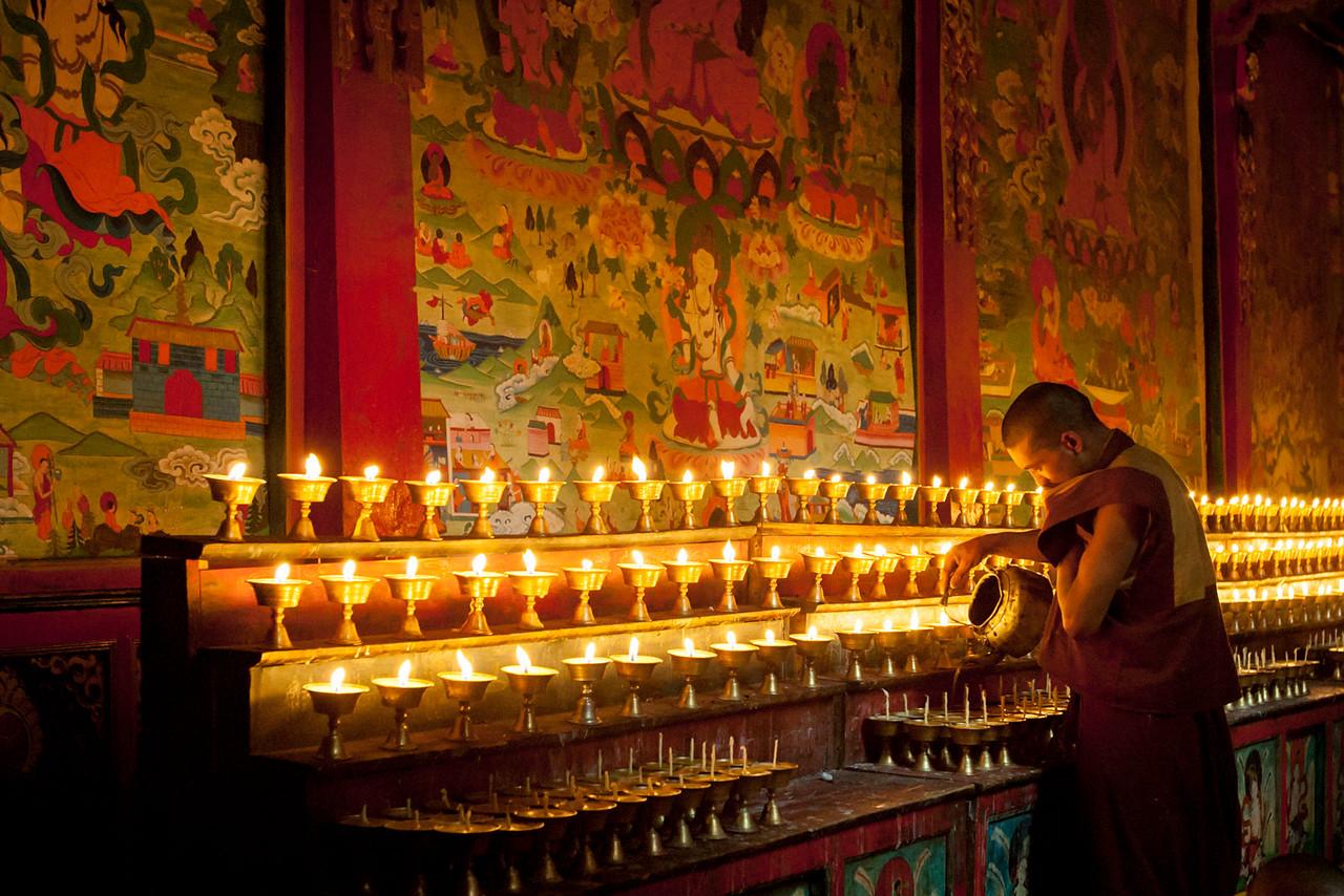 Refilling the butter lamps. Kathok Dorje Den Monastery, Kham (Sichuan)